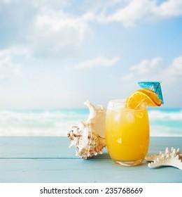 Orange cocktail on table
