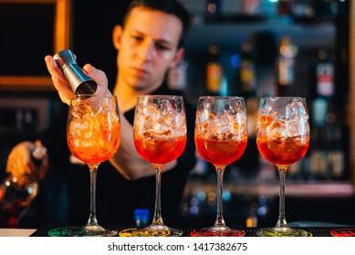orange cocktails on night party in dark room