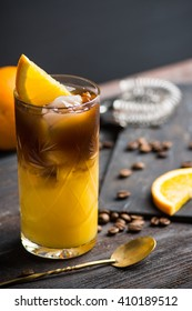 Orange and coffee cocktail on the wooden background