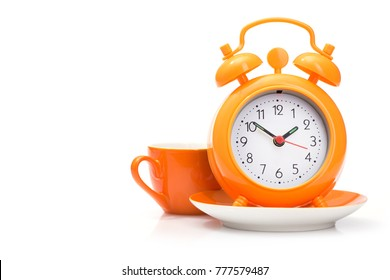 orange coffee cup and alarm clock isolated on white background, break in work