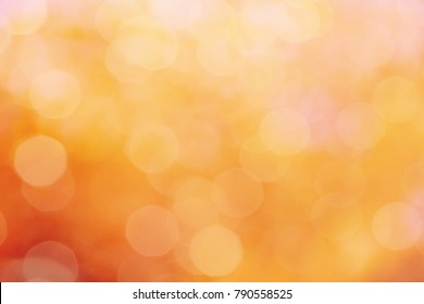 orange color abstract bacground withe blurred defocus bokeh light for template