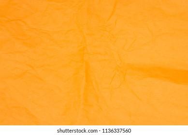 orange color creased tissue paper background texture