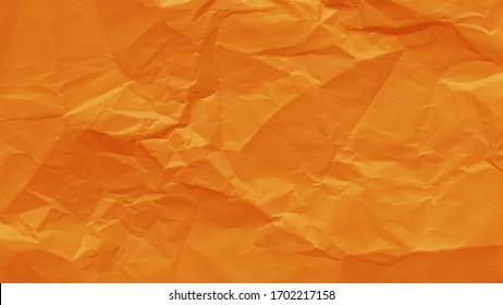 Orange color crumpled sheet of paper  background. Wrinkled texture.