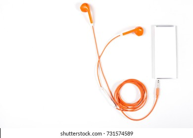orange color earphone with music player on white background.