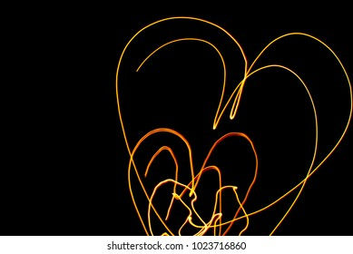 Orange Color Light Painting Photography Over Black Background