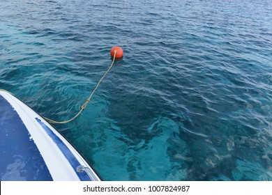 Orange color mooring Buoy floating on the Andaman sea near Similan islands, Phang Nga, Thailand.