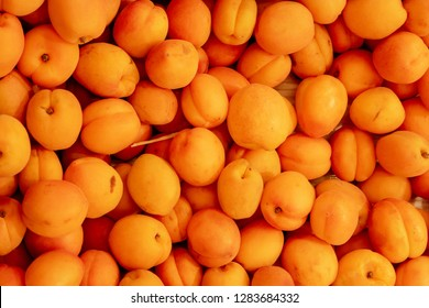 Orange Color Plums In Box Top View