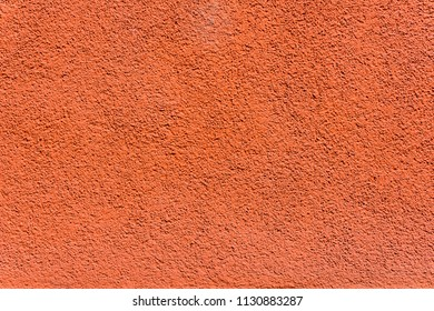 ORANGE COLORED STONE WALL TEXTURE
