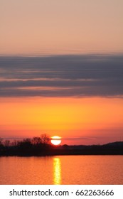 Orange colored Sunset on the Ohio River on a clear night.