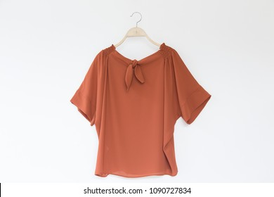Orange colour blouse women isolated on white background