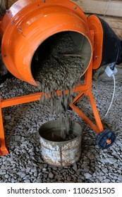 from an orange concrete mixer poured the finished solution into a bucket