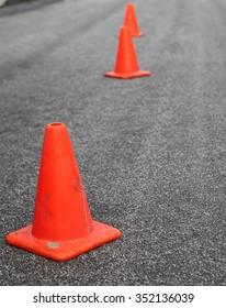 Orange cones in the street.