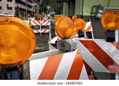 orange construction boards and flashing lights