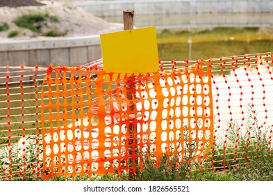 Orange Construction Fence Against A Black Background At A Stock Photo Alamy