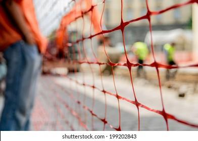orange construction site net around construction site