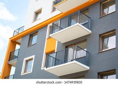 Orange contrasting elements in modern architecture. Bright accent. Architectural detail of a modern apartament building.