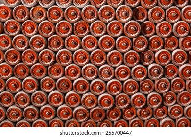 orange conveyor rollers lay down on the floor