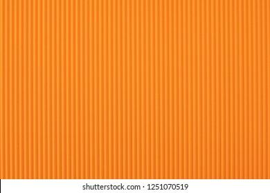 Orange corrugated cardboard close up. Large texture and background