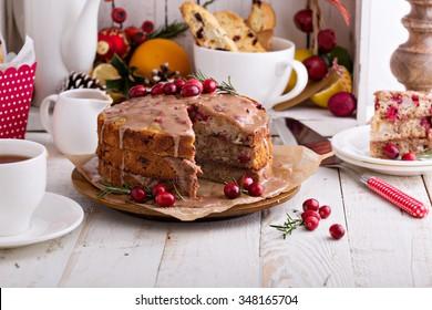 Orange and cranberry christmas cake with cinnamon glaze