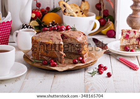 orange and cranberry christmas cake with cinnamon glaze