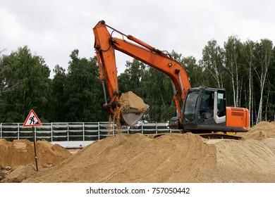 Orange crawler excavator
