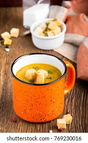 Orange cream soup in �up with croutons, carrot, pumpkin, delicious hot soup, homemade dinner in rustic style