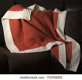 Orange crochet blanket on couch