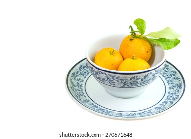 orange in the cup isolated on white background