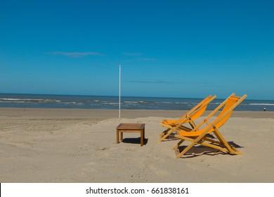 ORANGE DECKCHAIRS ON THE BEACH OF THE TOUQUET , PAS DE CALAIS , HAUTS DE FRANCE , FRANCE