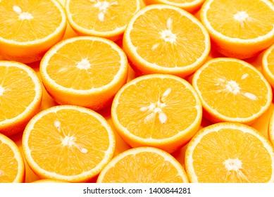 Orange delicious oranges divided in half lie in a row