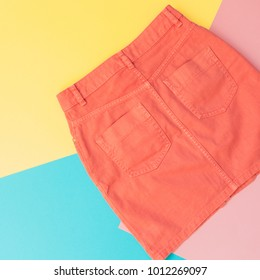 orange denim skirt for woman. pastel minimal, flat lay. summer and spring fashion concept