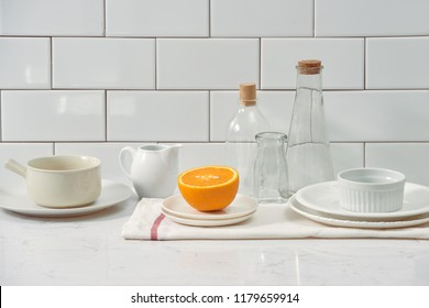 Orange in a dish on the table in the kitchen
