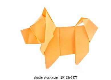 Orange dog chow-chow of origami, isolated on white background.