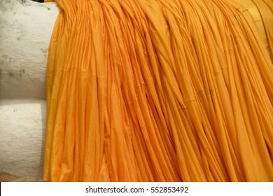 Orange drapery in a buddhist temple
