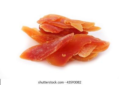 orange dried papaya slices over white background