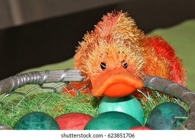 orange duck toy and Easter basket