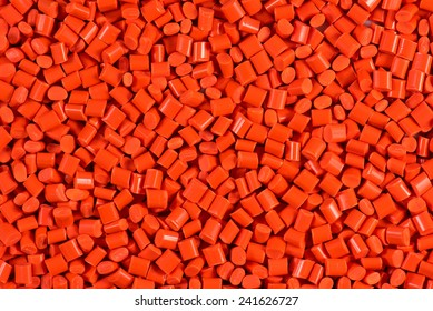 orange dyed plastic granulate for injection molding process