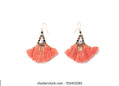Orange earrings with tassels isolated on white background
