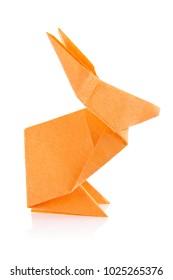 Orange easter bunny of origami, isolated on white background.