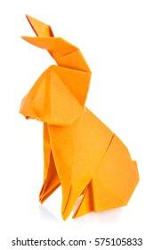 Orange easter bunny of origami, isolated on white background