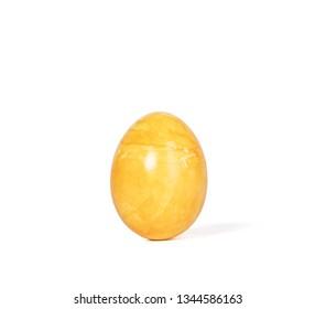 Orange easter egg isolated on white background