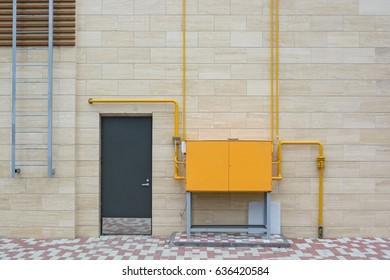 Orange electric box outside modern building - Shutterstock ID 636420584