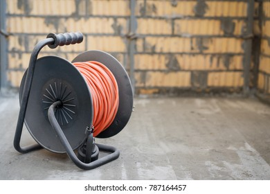 Orange electrical power extension cable reel at the repairs site