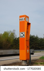 Orange emergency phone on a Czech highway.