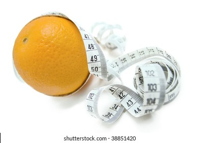 Orange entangled with measuring tape - abstract healthy food symbol