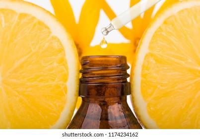 Orange Essential Oil. Essential oil with lemon, natural remedies.