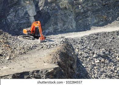 Orange excavator on a working platform