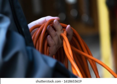 orange extention cord ready to use to plug in electric items