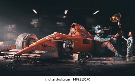 orange f1 racing car in the garage