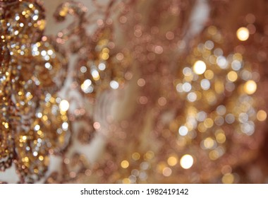 Orange fabric background with abstract  glitter silver lights. defocused. Natural shimmering